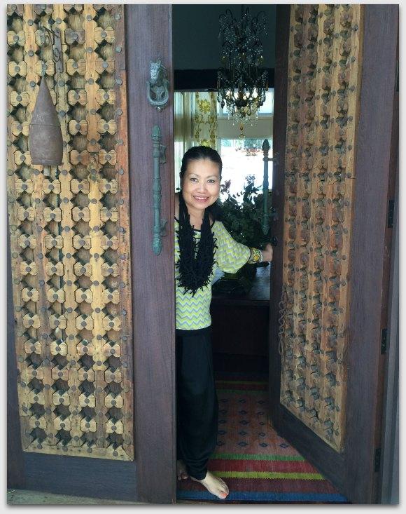 Sher in the open doorway to her home