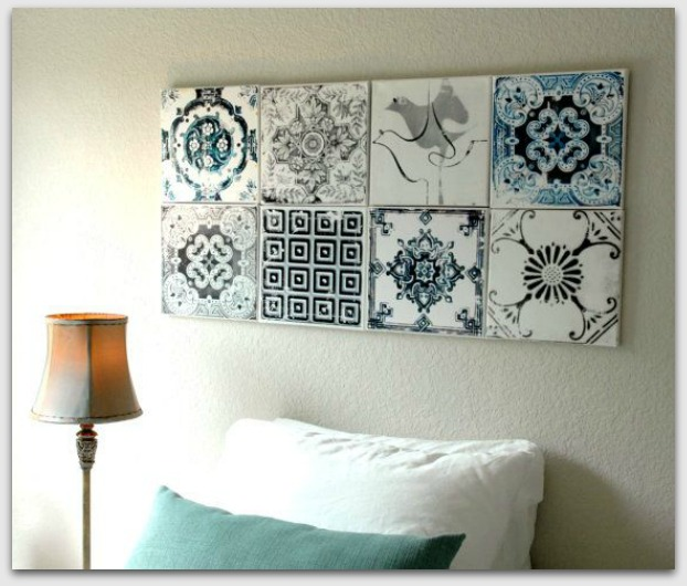 Tiles grouped as art above bed
