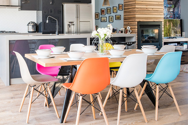 Multi coloured chairs around the dining table
