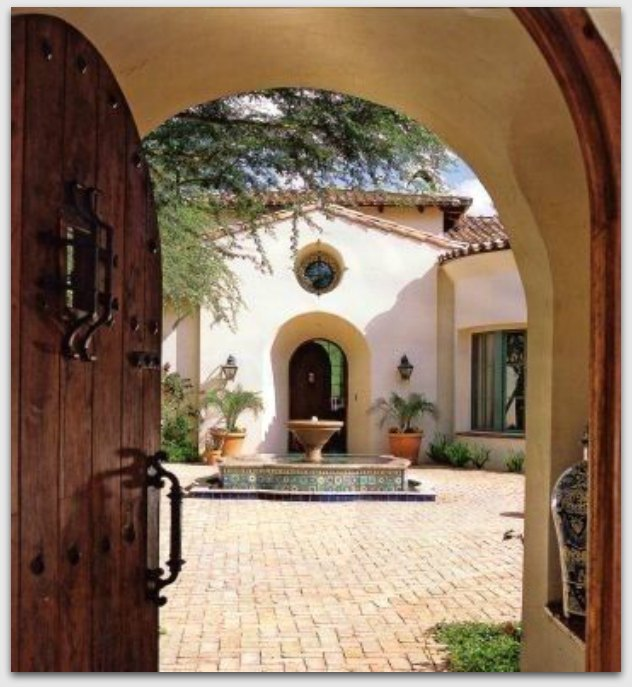 Spanish Arch with heavy wood door