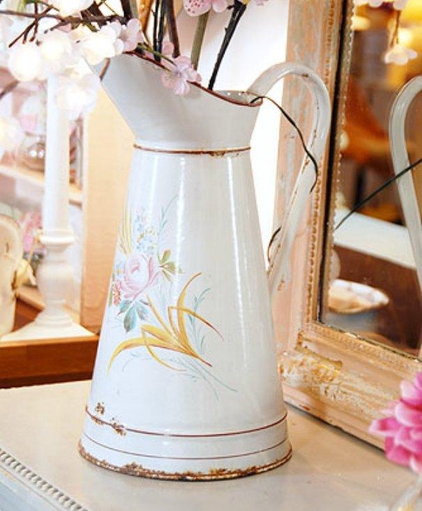 enamel jug used as a vase