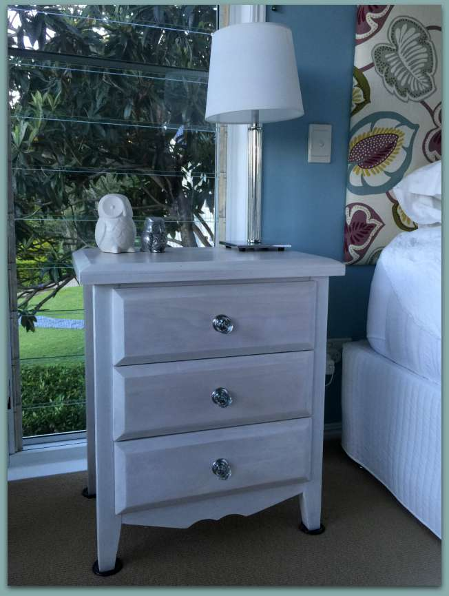 whitewashed bedside table